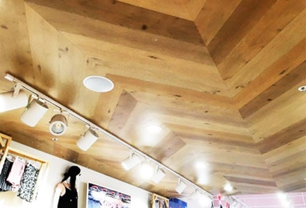 diagonal plywood ceiling design in clothes section of a shopping centre