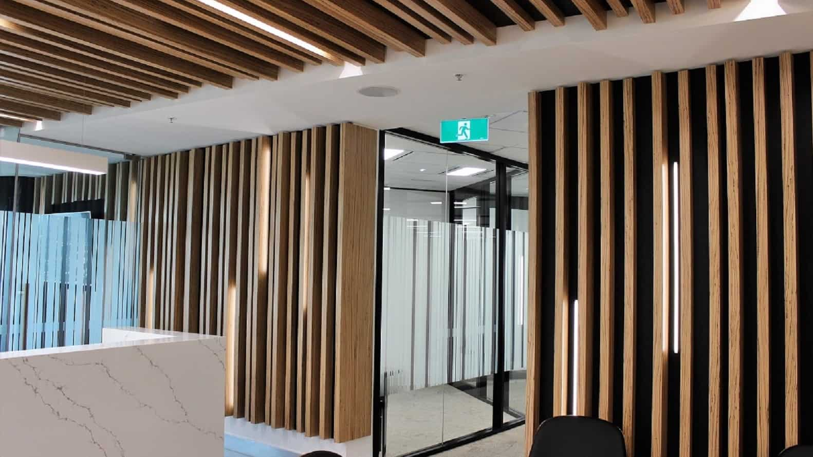 exposed vertical wood ceiling beams with matching wood panel for walls