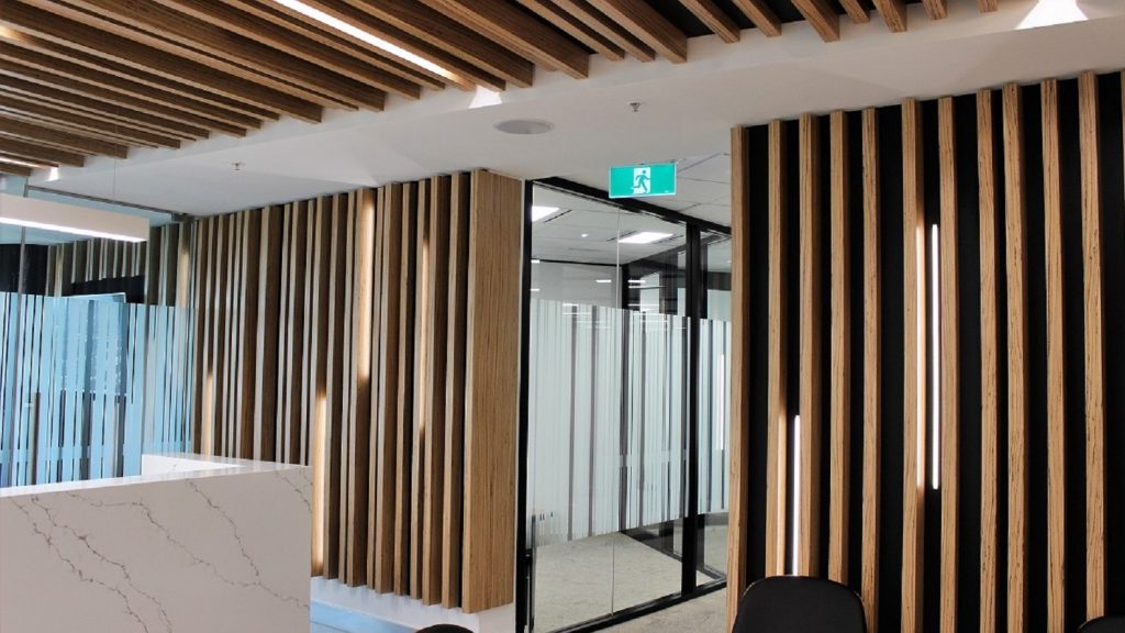 vertical wood ceiling beams with matching wood panel for walls