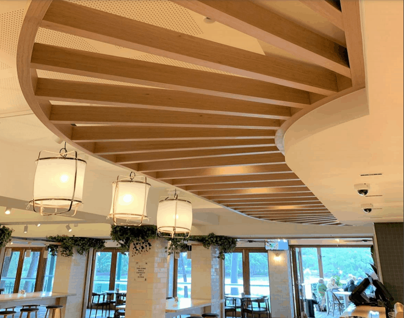 wooden beams curve design near the counter