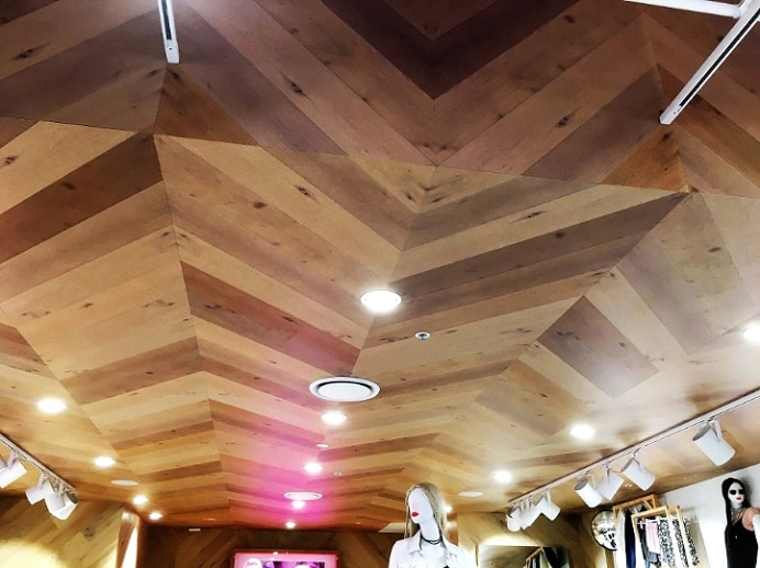 diagonal wood ceiling pile up in a clothes store