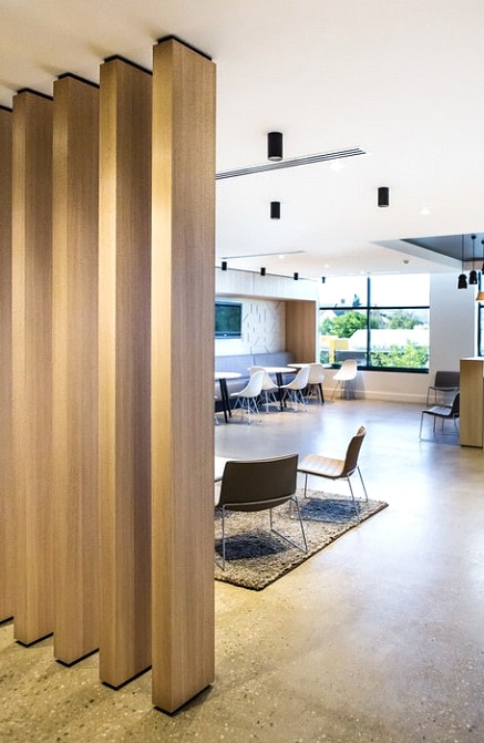 vertical wood shutters in a living room partition design