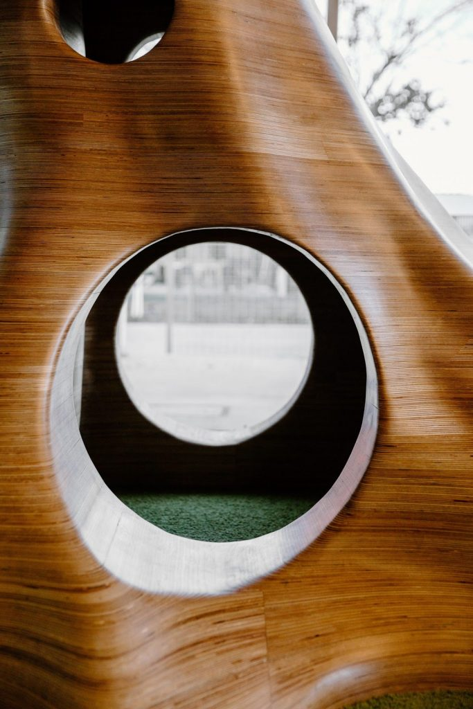 inside the beautiful tree design made from plywood for children's space in a library
