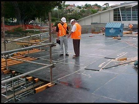engineers in an under construction floor stage