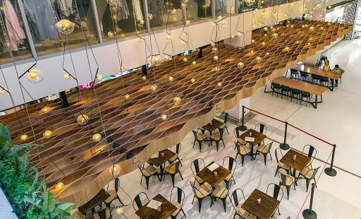 bendy plywood ceilings that matches dining tables use in shopping centres